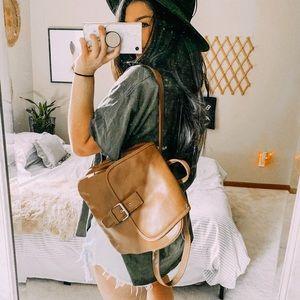 Vintage tan leather boho hipster backpack